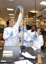 Sophomore level chemical engineering students in lab doing a hands-on experiments
