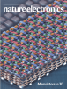 "cover of the current (april 2020) issue of Nature Electronics, captioned ""memristors in 3D""t"