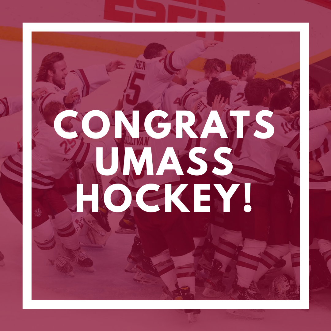 UMass Hockey team embraces after win